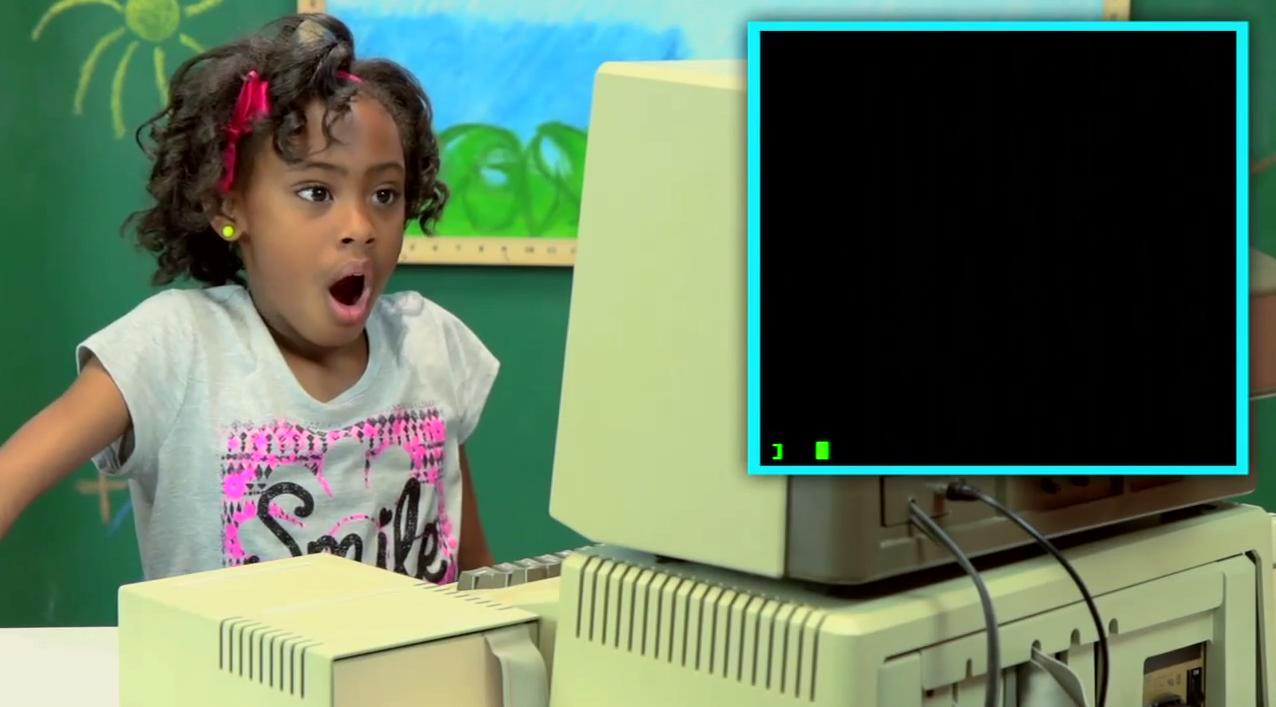 Kinder an einem Apple II Computer.